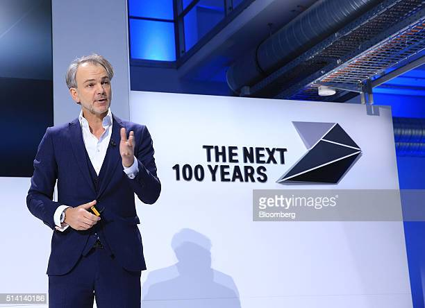 Adrian van Hooydonk chief designer at Bayerische Motoren Werke AG gestures as he speaks during a news conference as BMW celebrate the company's 100th...