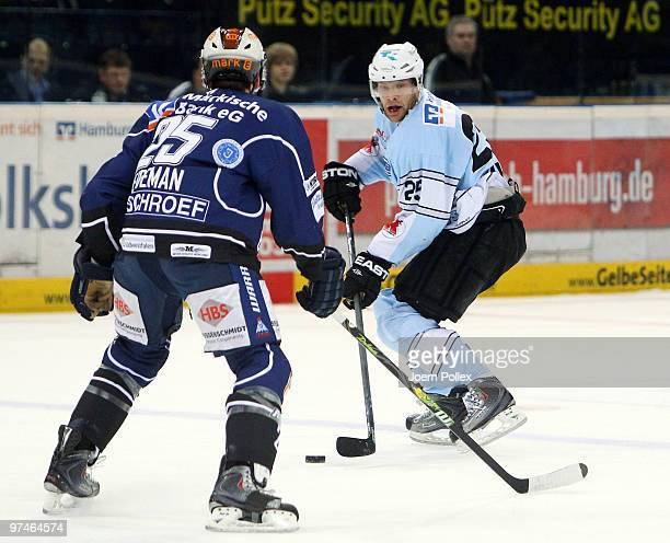 Adrian Veidemann of Iserlohn challenges Clarke Wilm of Hamburg during the DEL match between Hamburg Freezers and Iserlohn Roosters at the Color Line...