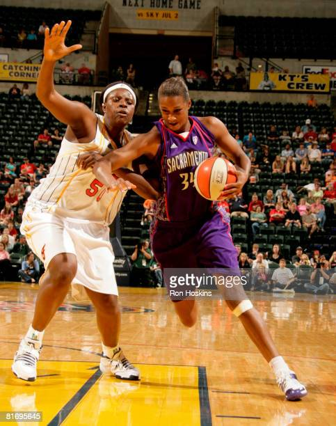 Adrian WilliamsStrong of the Sacramento Monarchs drives on Bernadette Ngoyisa of the Indiana Fever at Conseco Fieldhouse June 24 2008 in Indianapolis...