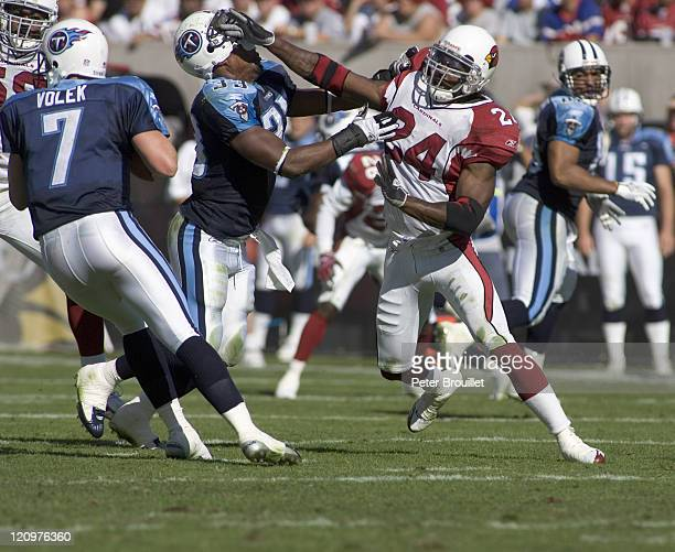 Adrian Wilson strong safety for the Arizona Cardinals rips the helmet off Jarrett Payton while pass rushing in a game against the Tennessee Titans at...