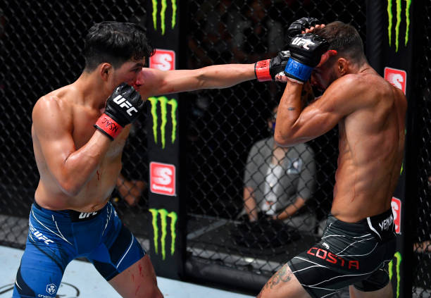 Adrian Yanez punches Randy Costa in their bantamweight fight during the UFC Fight Night event at UFC APEX on July 24, 2021 in Las Vegas, Nevada.