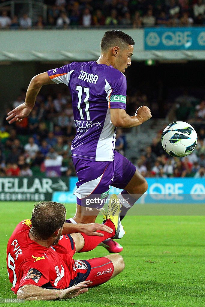 Adrian Zahra of the Glory is challenged for the ball by Iain Fyfe of Adelaide during the round twenty seven A-League match between Perth Glory and Adelaide United at nib Stadium on March 30, 2013 in Perth, Australia.