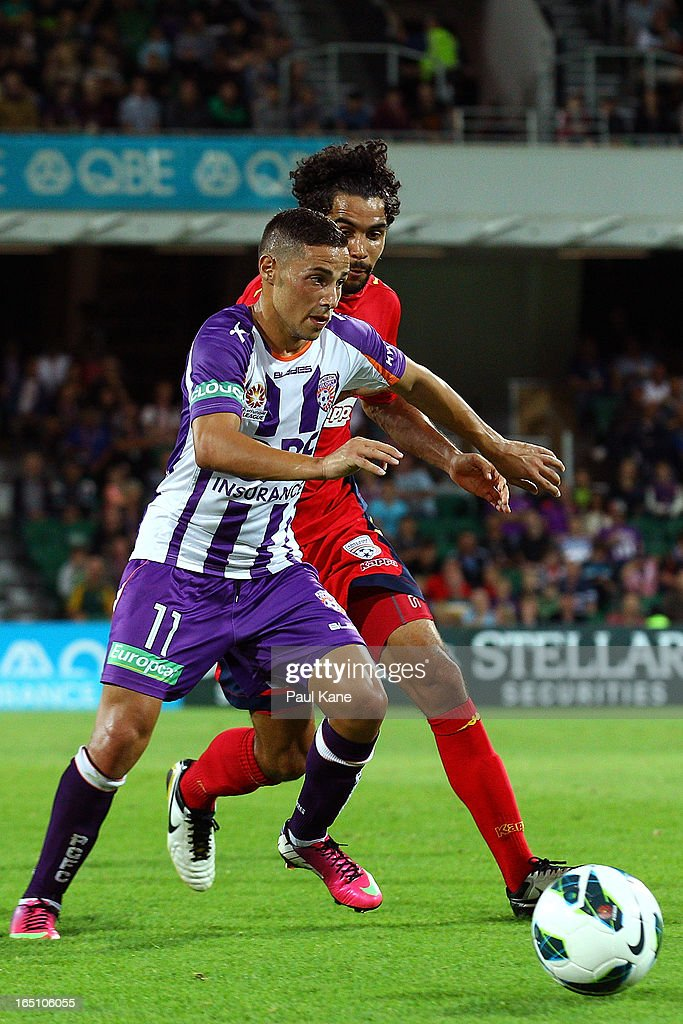 Adrian Zahra of the Glory is challenged for the ball by Osama Malik of Adelaide during the round twenty seven A-League match between Perth Glory and Adelaide United at nib Stadium on March 30, 2013 in Perth, Australia.