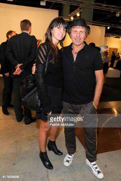 Adriana Alessi and Renzo Russo attend ART BASEL Fair 2010 at Miami Beach Convention Center on December 4 2010 in Miami Beach Florida