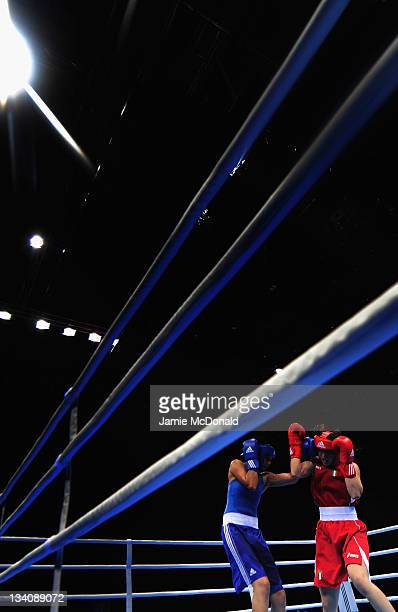 Adriana Arujo of Brazil punches Cheng Dong of China during their quaterfinal 57kg60kg bout at ExCel on November 25 2011 in London England