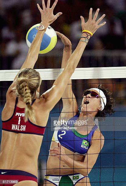 Adriana Behar of Brazil spikes the ball to Kerri Walsh of United States in the women's gold medal match on August 24, 2004 during the Athens 2004...
