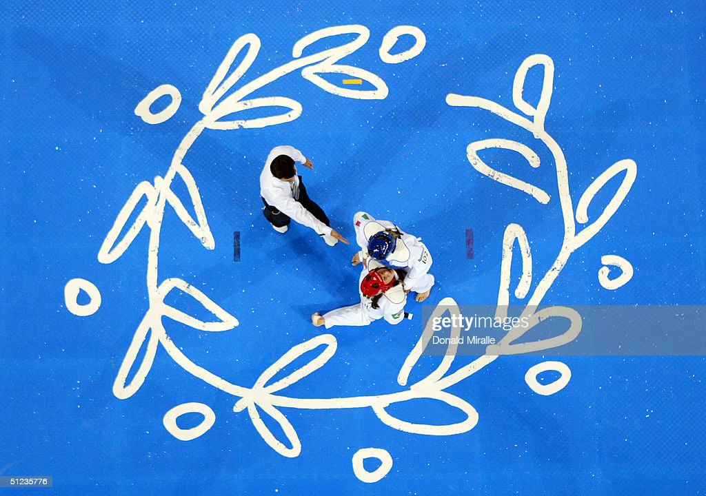 Adriana Carmona (L) of Venezuala defeats Natalie Silva of Brazil in the women's over 67 kg Taekwondo bronze medal match on August 29, 2004 during the Athens 2004 Summer Olympic Games at the Sports Pavilion part of the Faliro Coastal Zone Olympic Complex.