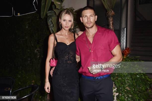 Adriana Cernanova and Adam Senn attend Dolce Gabbana Naked King at Milan Men's Fashion Week Spring/Summer 2019 on June 16 2018 in Milan Italy