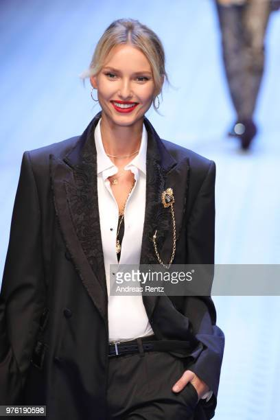 Adriana Cernanova walks the runway at the Dolce Gabbana show during Milan Men's Fashion Week Spring/Summer 2019 on June 16 2018 in Milan Italy