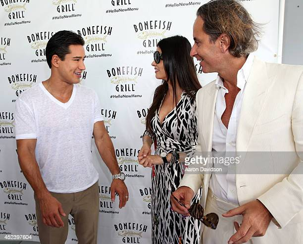 Adriana De Moura and Frederic Marq attend Bonefish Grill's new menu launch with celebrity host Mario Lopez at Fontainebleau Miami Beach on July 19...