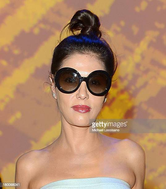 Adriana De Moura of 'Real Housewives of Miami' attends the Custo Barcelona fashion show during MercedesBenz Fashion Week Spring 2014 at The Stage at...