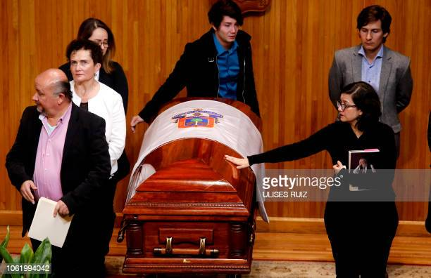 Adriana del Paso the daughter of Mexican writer Fernando del Paso holds a book written by her father as she touches his coffin during a posthumous...
