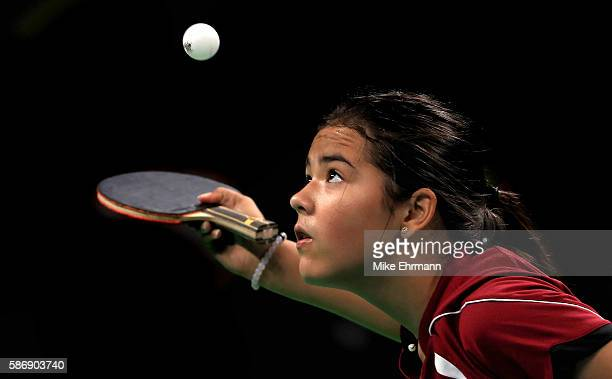 Adriana Diaz of Puerto Rico plays a Women's Singles second round match against Xue Li of France on Day 2 of the Rio 2016 Olympic Games at Riocentro...