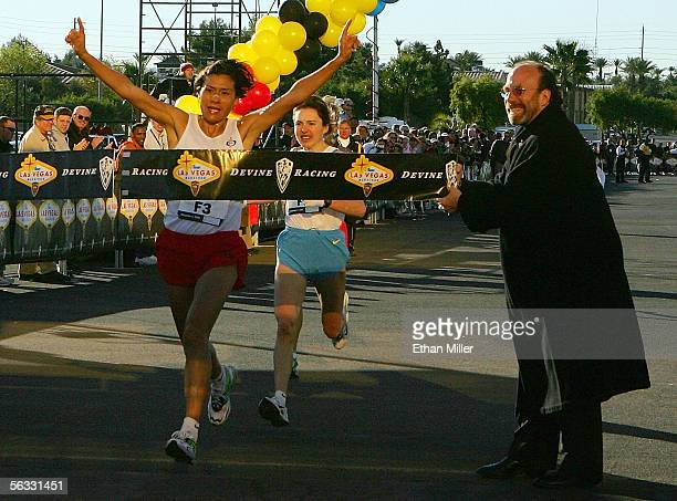 Adriana Fernandez of Mexico wins first place among women runners just ahead of secondplace finisher Galina Bogomolva of Russia at the inaugural...