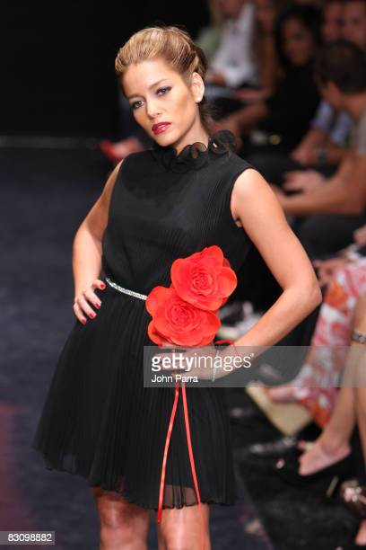 Adriana Fonseca walks the runway at the Red Dress Show for the American Heart Association during Funkshion Fashion Week at Miami Beach Botanical...