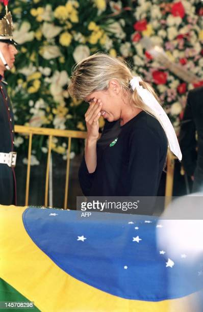 Adriana Galisteu girlfriend of Formula One champion Ayrton Senna cries as she visit his coffin on May 04 at the Sao Paulo Legislative Assembly Brazil...