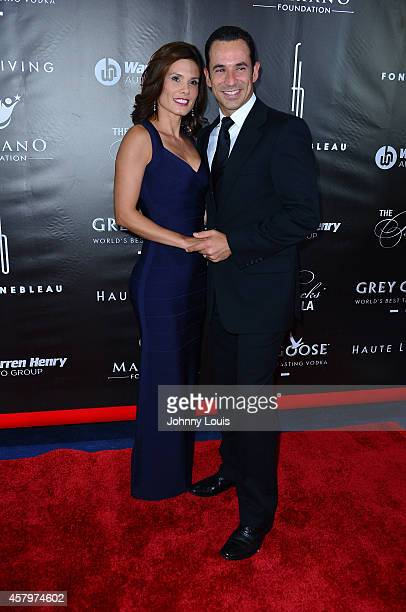 Adriana Henao and Helio Castroneves attend The Blacks Annual Gala at Fontainebleau Miami Beach on October 25 2014 in Miami Beach Florida