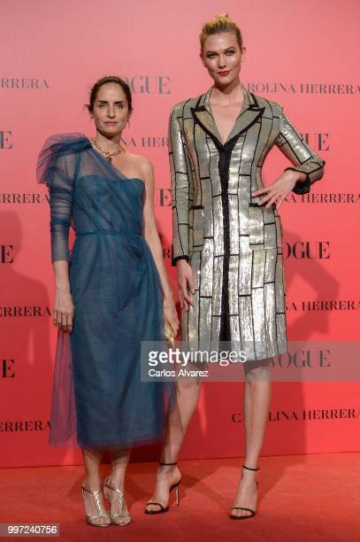Adriana Herrera and Karlie Kloss attend Vogue 30th Anniversary Party at Casa Velazquez on July 12 2018 in Madrid Spain