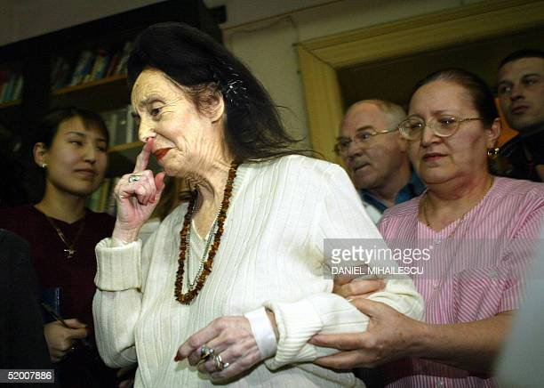 Adriana Iliescu is helped by medical personel as she arrive at a press conference at the Giulesti Maternity Hospital in Bucharest Romania 18 January...