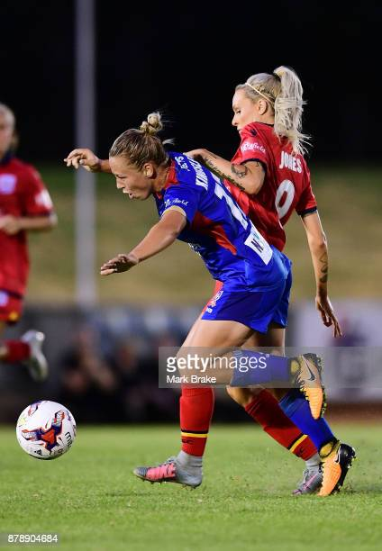 Adriana Jones of Adelaide United fouls Jenna Kingsley of Newcastle Jets during the round five WLeague match between Adelaide United and Newcastle...