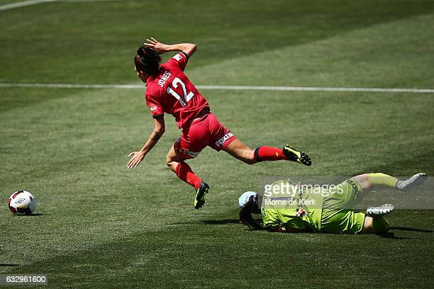 Adriana Jones of Adelaide United is tackled by Shamiran Khamis of Sydney during the round 14 W-League match between Adelaide United and Sydney FC at...