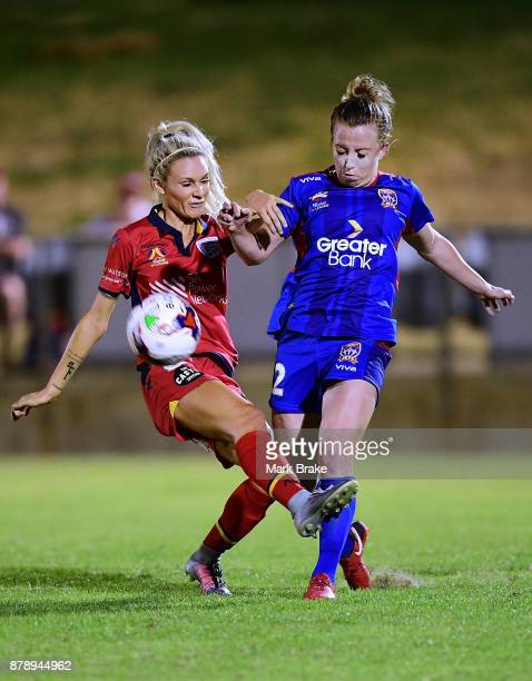 Adriana Jones of Adelaide United tackles Hannah Brewer of Newcastle Jets during the round five WLeague match between Adelaide United and Newcastle...