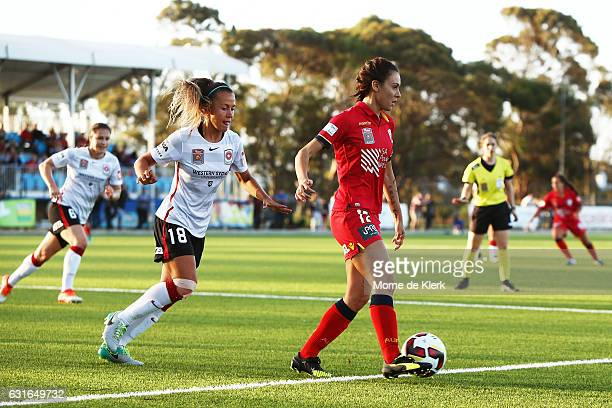 Adriana Jones of Adelaide United wins the ball in front of Angelique Hristodoulou of Western Sydney during the round 12 WLeague match between...