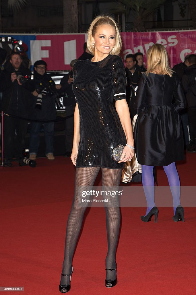 Adriana Karembeu attends the 15th NRJ Music Awards at Palais des Festivals on December 14, 2013 in Cannes, France.