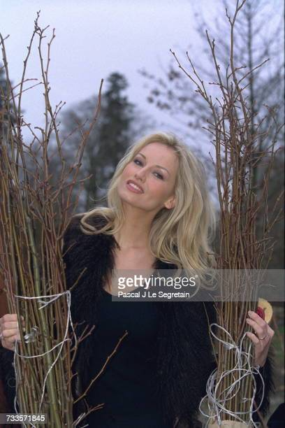 Adriana Karembeu plants one of 120 linden trees presented by the Slovak Presidency