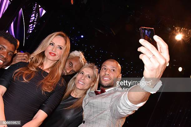 Adriana Karembeu Satya Oblette a guest and Xavier Delarue pose for a selfie during the 'Top Model Belgium 2016' Ceremony at Le Lido on January 24...