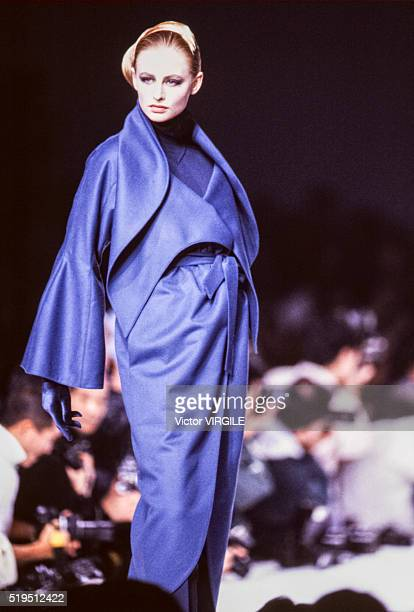 Adriana Karembeu walks the runway at the Claude Montana Ready to Wear Fall/Winter 19891990 fashion show during the Paris Fashion Week in March 1989...