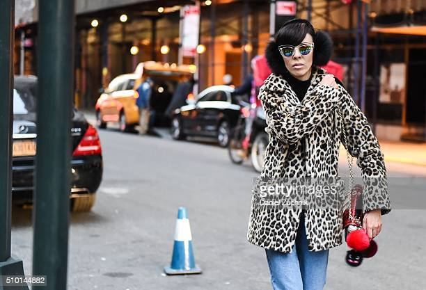 Adriana Kubieniec is seen outside the Alexander Wang show wearing an animal print coat, H&M black turtleneck, Topshop blue jeans, DVF bag and Forever...
