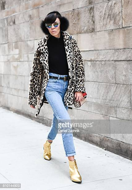 Adriana Kubieniec is seen outside the Alexander Wang show wearing an animal print coat HM black turtleneck Topshop blue jeans Zara gold shoes DVF bag...