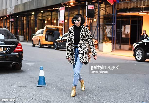 Adriana Kubieniec is seen outside the Alexander Wang show wearing an animal print coat, H&M black turtleneck, Topshop blue jeans, Zara gold shoes,...