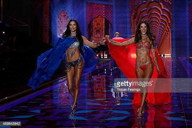 Adriana Lima and Alessandra Ambrosio on the runway at the 2014 Victoria's Secret Runway Show Swarovski Crystal Looks at Earl's Court Exhibition...