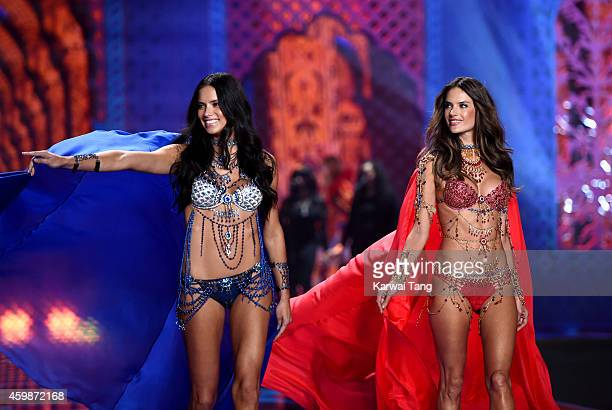 Adriana Lima and Alessandra Ambrosio walk the runway at the annual Victoria's Secret fashion show at Earls Court on December 2 2014 in London England