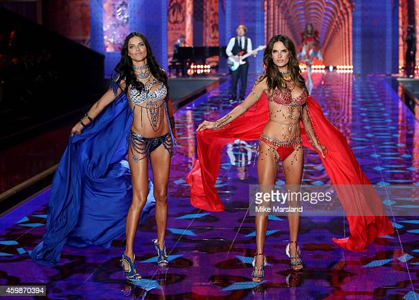 Adriana Lima and Alessandra Ambrosio walks the runway at the annual Victoria's Secret fashion show at Earls Court on December 2 2014 in London England