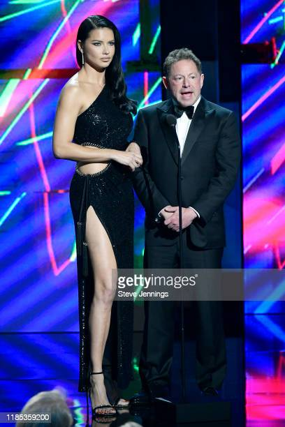 Adriana Lima and Bobby Kotick speak onstage during the 2020 Breakthrough Prize at NASA Ames Research Center on November 03 2019 in Mountain View...