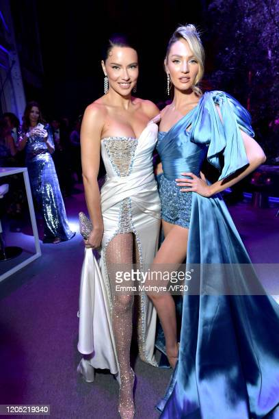 Adriana Lima and Candice Swanepoel attend the 2020 Vanity Fair Oscar Party hosted by Radhika Jones at Wallis Annenberg Center for the Performing Arts...