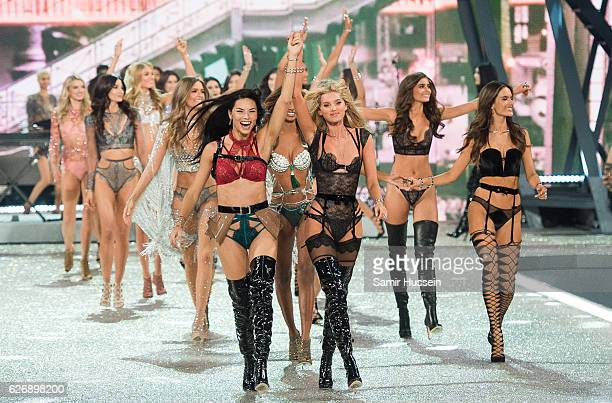 Adriana Lima and Elsa Hosk lead out models as they walk the runway during the annual Victoria's Secret fashion show at Grand Palais on November 30...