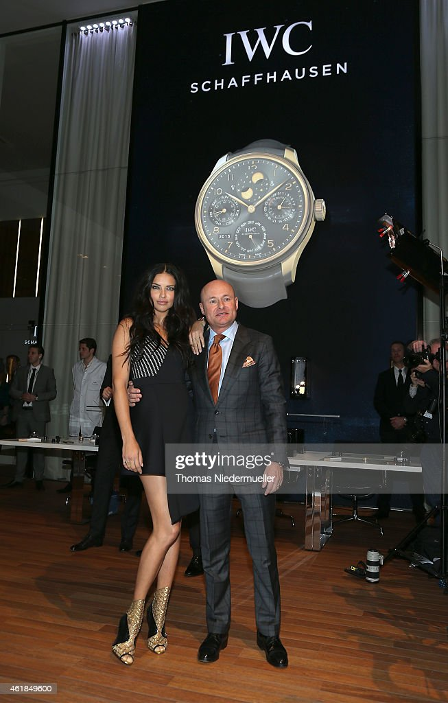 Adriana Lima and IWC Schaffhausen CEO George Kern visits the IWC booth during the Salon International de la Haute Horlogerie (SIHH) 2015 at the Palexpo on January 20, 2015 in Geneva, Switzerland.