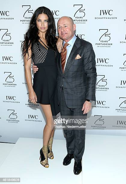 Adriana Lima and IWC Schaffhausen CEO George Kern visits the IWC booth during the Salon International de la Haute Horlogerie 2015 at the Palexpo on...