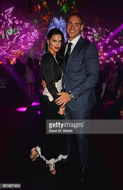 Adriana Lima and Joe Indulge attend the Chopard Wild Party during the 69th Annual Cannes Film Festival at Port Canto on May 16 2016 in Cannes