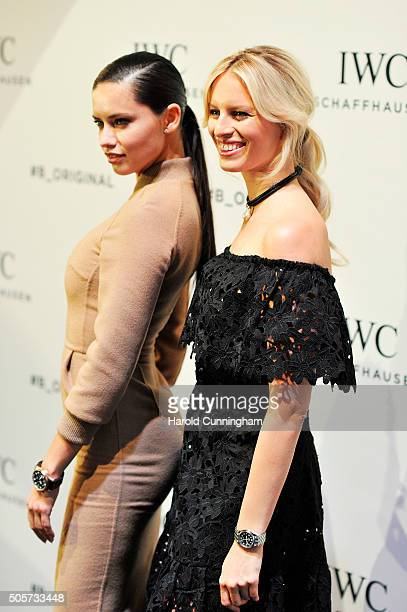 Adriana Lima and Karolina Kurkova visit the IWC booth during the launch of the Pilot's Watches Novelties from the Swiss luxury watch manufacturer IWC...