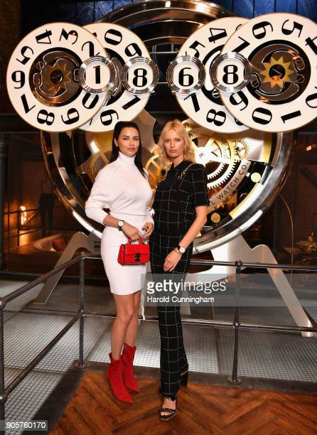 Adriana Lima and Karolina Kurkova visit the IWC booth during the Maison's launch of its Jubilee Collection at the Salon International de la Haute...