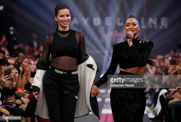 Adriana Lima and Nicole Scherzinger walk the runway at the Maybelline New York show 'Makeup that makes it in New York' during the Berlin Fashion Week...