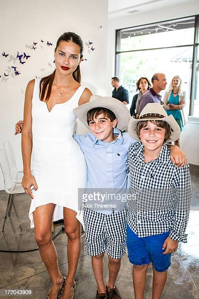 Adriana Lima and some young admirers at Adriana Lima Hosts Russell James Exhibition Opening at 212 Gallery on June 28 2013 in Aspen Colorado