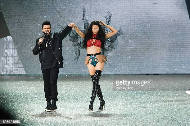 Adriana Lima and The Weeknd walk the runway 2016 Victoria's Secret Fashion Show in Paris Show at Le Grand Palais on November 30 2016 in Paris France