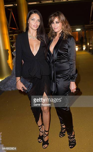 Adriana Lima and Yasmin Le Bon attend the Ralph Russo And Chopard Host Dinner as part of Paris Fashion Week on July 4 2016 in Paris France