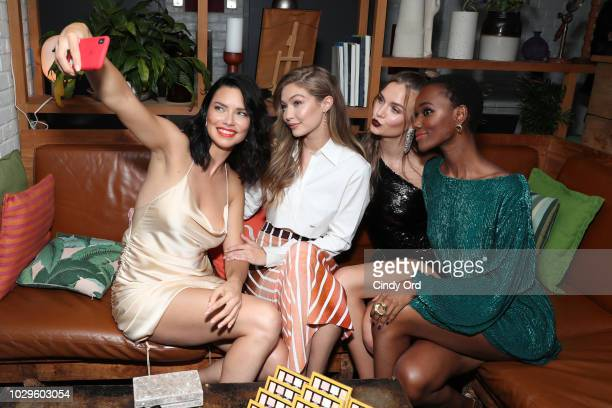 Adriana Lima Gigi Hadid Josephine Skriver and Herieth Paul take a selfie at the Maybelline x New York Fashion Week XIX Party at Mr Purple at the...
